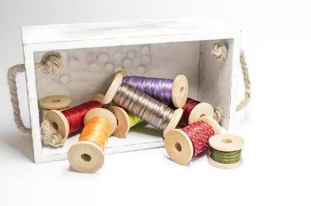 Box with ribbon on spools Stock Photo
