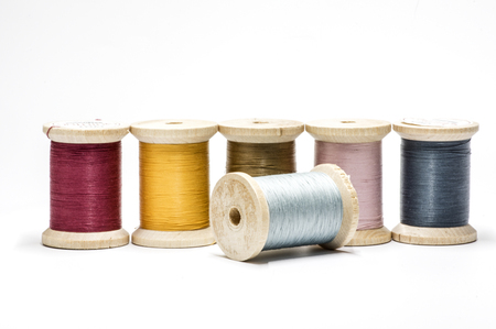A row of sewing threads on spools