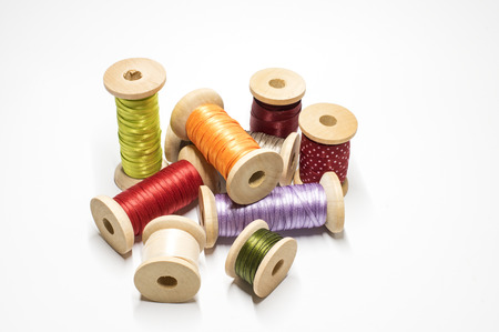 Wooden spools with satin ribbon