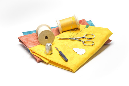 Yellow fabric and sewing tools