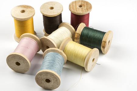 Wooden spools with sewing thread