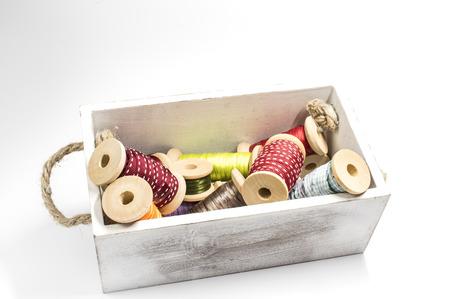 Box with ribbon spools