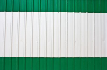 Corrugated steel sheet useful as a background paint white and green color photo