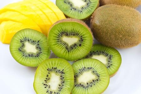 Kiwi and mango fruit isolated on white background Standard-Bild