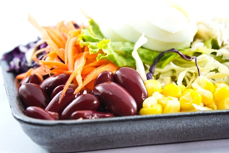 fresh vegetable salad with bean,corn in plate photo