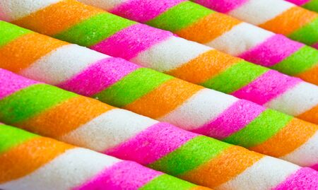 Close-up of striped wafer rolls colorful  .Background or texture photo
