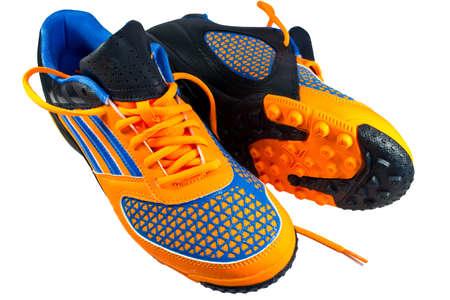 Fußball Schuhe auf dem weißen Hintergrund isoliert