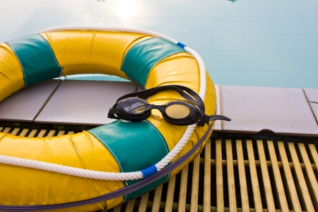 Swimming glasses on the life preserver floating photo