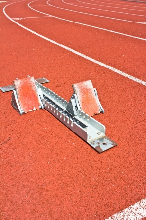 Athletics Starting Blocks on a red running track photo