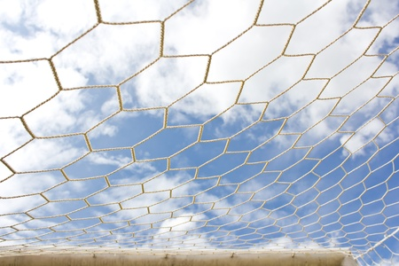 Soccer goal net on  blue sky photo