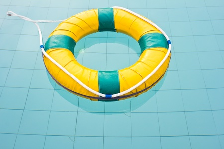 Life preserver floating in a  swimming pool photo