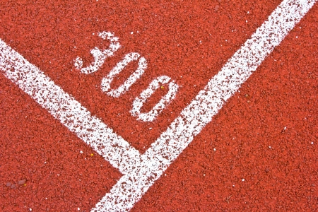 Number three hundred on running track rubber standard red color photo