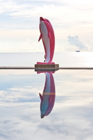 Pool water and pink dolphin statue at khanom bay. photo