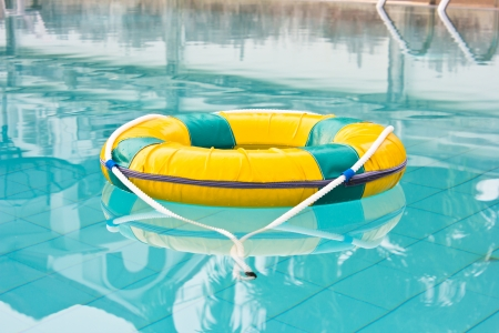 Life preserver floating in a  pool water photo
