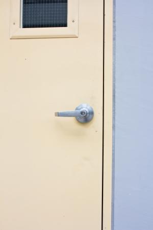 Aluminum door knob on the door photo