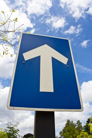 fork in path: Traffic road sign isolated on blue sky