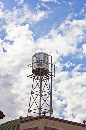 water tower on blue sky background photo