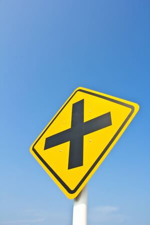intersection sign in blue sky photo