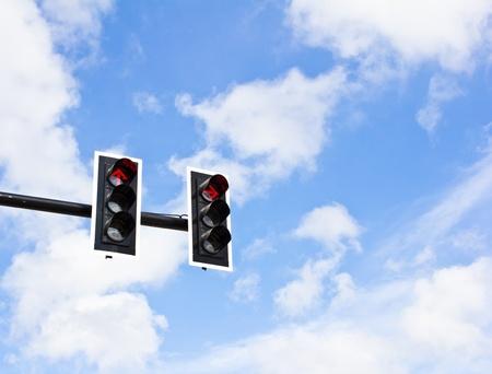 Traffic lights on blue sky background photo