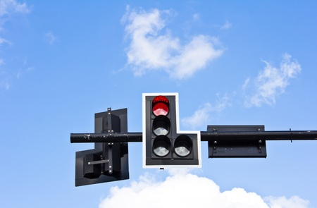 Traffic lights on blue sky background photo