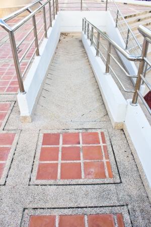 using wheelchair ramp Standard-Bild