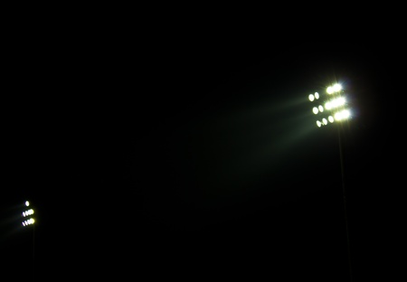 Stadium floodlights on a sports field at night photo