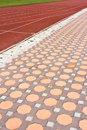 Running track  with details of  design stone floor tiles  in the stadium photo