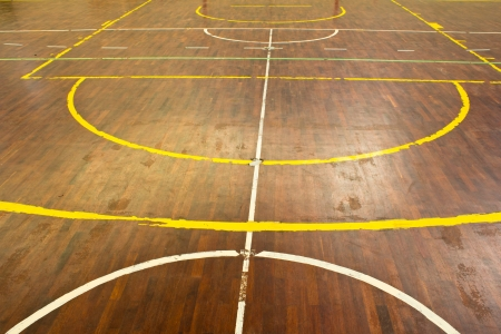 Wooden floor of sports hall with marking lines photo