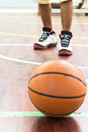 Basketball over floor. Close up. photo