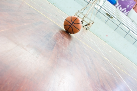 Basketball ball over floor. close up. Stock Photo - 19240272