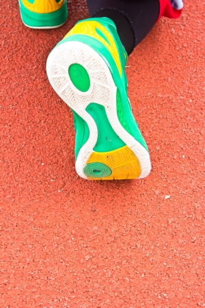 closeup of running shoes in the stadium photo