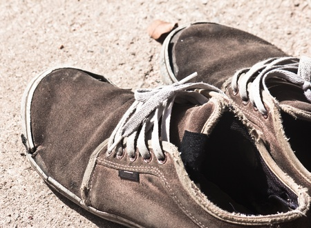 old sneaker  on grungy background photo