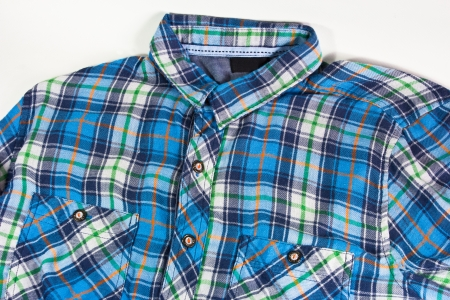 checkered polo shirt: blue shirt on white background