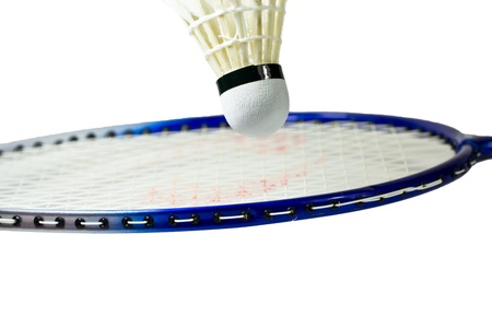 Badminton rackets and shuttlecock isolated on white  background photo