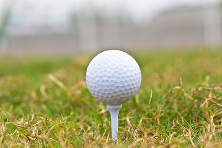 Close up golf ball on  course photo