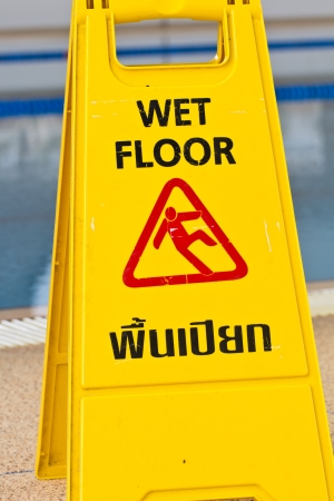 Sign advising caution on wet floor photo
