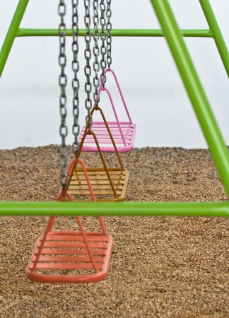 Empty chain swings on park  playground photo