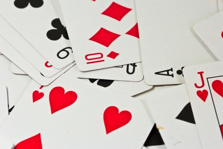 Playing cards isolated on background photo