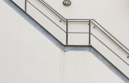 Fire escape ladder on the side of  building Stock Photo