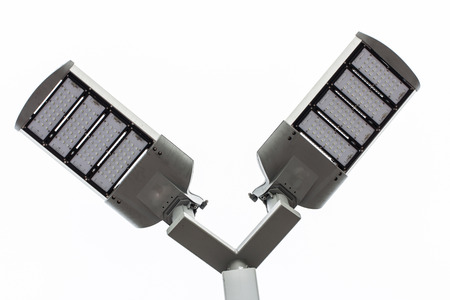 LED street lamps post on white background photo