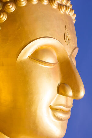 photo of buddha face statue photo