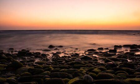 Beautiful long exposure of sunrise over the sea