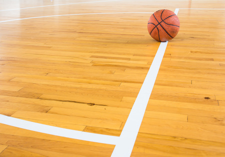 background basketball court: Basketball ball over floor in the gym