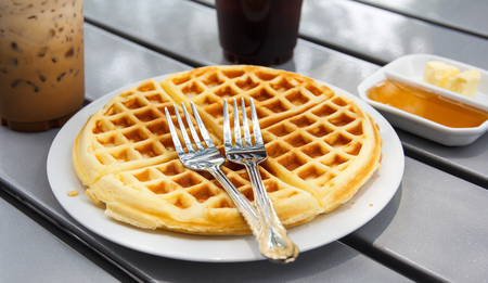 fresh waffle  in white plate on the table photo