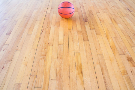 basket ball: Basketball ball over floor in the gym