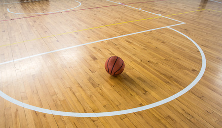 Basketball ball over floor in the gym photo