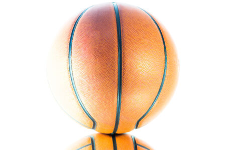 Basketball isolated on a white background with light effect