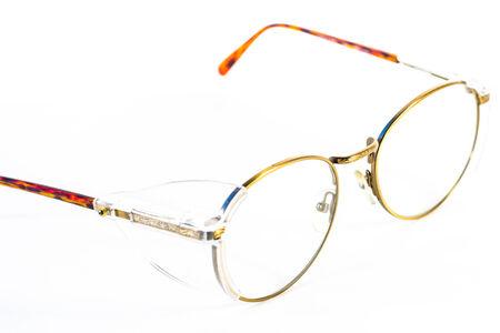 bifocals: Vintage round eyeglasses isolated on white