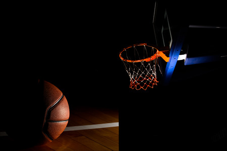 Basketball hoop on  black background with light effect photo