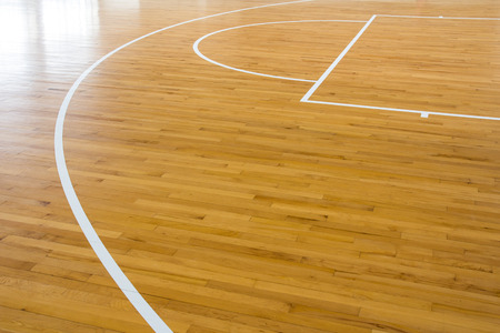 wooden floor basketball court with light effect 免版税图像